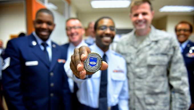 Chief honors Airman with coin
